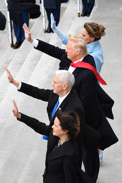 . President Donald Trump, first lady Melania Trump, Vice President Mike Pence, and Karen Pence wave as former President Barack Obama and Michelle Obama depart during the 2017 Presidential Inauguration at the U.S. Capitol. (Jack Gruber/Pool Photo via AP)