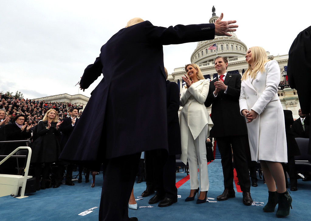 . President Donald Trump walks to his family after taking the oath of office from Chief Justice John Roberts Friday, Jan. 27, 2017 on Capitol Hill in Washington. (Jim Bourg/Pool Photo via AP)