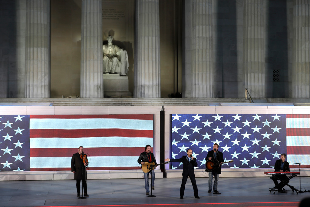 """. Lee Greenwood sings, third from left, with the backing of the Frontmen of Country at a pre-Inaugural \""""Make America Great Again! Welcome Celebration\"""" at the Lincoln Memorial in Washington, Thursday, Jan. 19, 2017. (AP Photo/David J. Phillip)"""