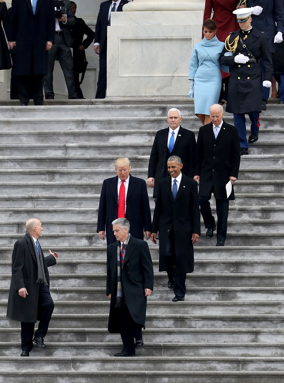 . President Donald Trump and former president Barack Obama walks on the steps of the Capitol in Washington, Friday, Jan. 20, 2017, with Vice President Mike Pence and former Vice President Joe Biden along with with first lady Melania Trump and Michelle Obama, prior to the Obama\'s departure to Andrews Air Force Base, Md., following the presidential inauguration. (Rob Carr/Pool Photo via AP)