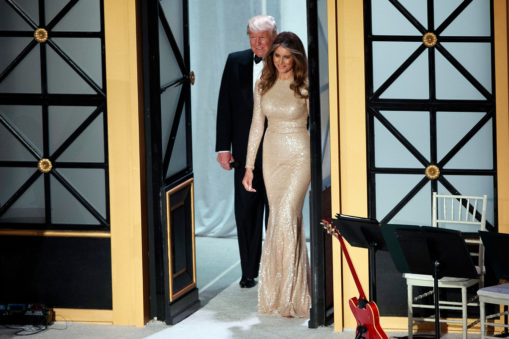 . President-elect Donald Trump and his wife Melania arrive to a VIP reception and dinner with donors, Thursday, Jan. 19, 2017, in Washington. (AP Photo/Evan Vucci)