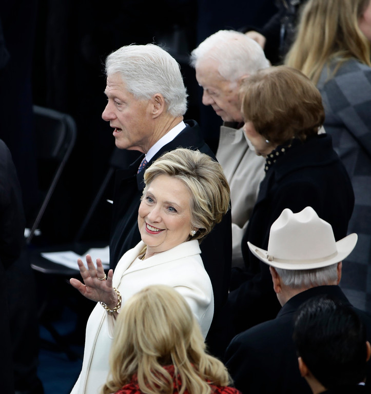 . Former President Bill Clinton and Former Secretary of State Hillary Clinton during the 58th Presidential Inauguration at the U.S. Capitol in Washington, Friday, Jan. 20, 2017. (AP Photo/Matt Rourke)