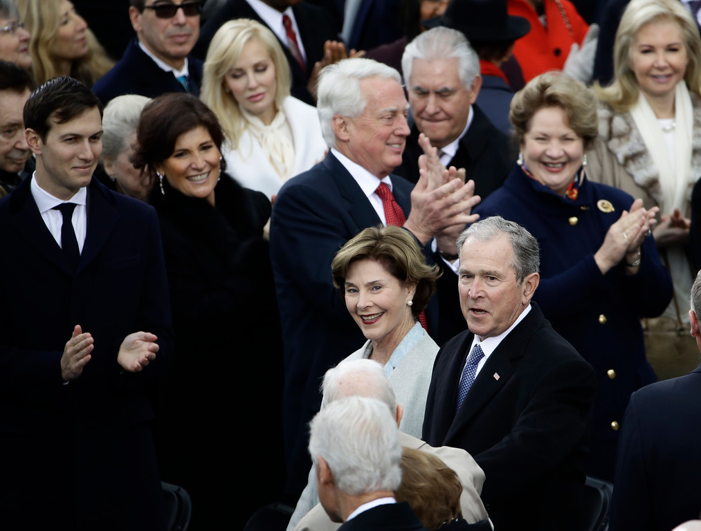 . Former President George W. Bush and his wife Laura arrive for the 58th Presidential Inauguration at the U.S. Capitol in Washington, Friday, Jan. 20, 2017. (AP Photo/Matt Rourke)