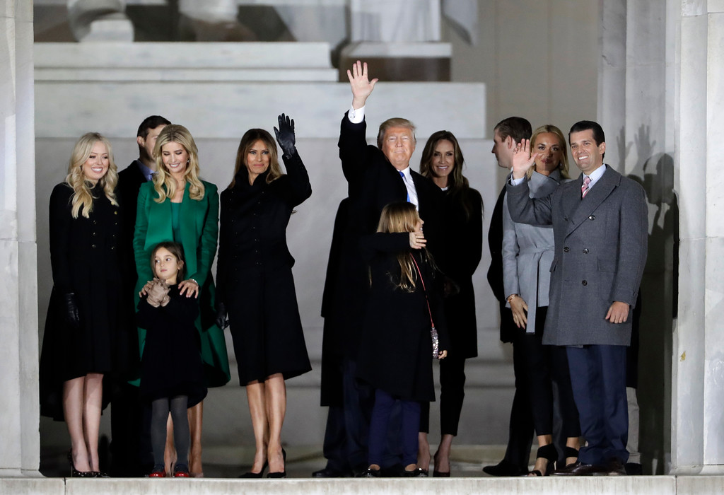 ". President-elect Donald Trump and his wife Melania Trump stand with family at a pre-Inaugural ""Make America Great Again! Welcome Celebration\"" at the Lincoln Memorial in Washington, Thursday, Jan. 19, 2017. (AP Photo/David J. Phillip)"