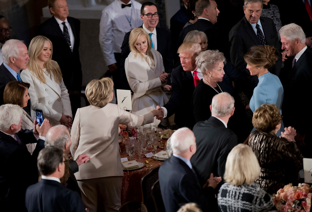 . Newly sworn in President Donald Trump with his wife first lady Melania Trump, shakes hands with Hillary Clinton, as they arrive for the inaugural luncheon at the Statuary Hall in the Capitol, Friday, Jan. 20, 2017, in Washington. President Trump became the 45th president of the United States. Others are former President Bill Clinton, right, and Trump\'s daughter Tiffany Trump, second from left. (AP Photo/Manuel Balce Ceneta)