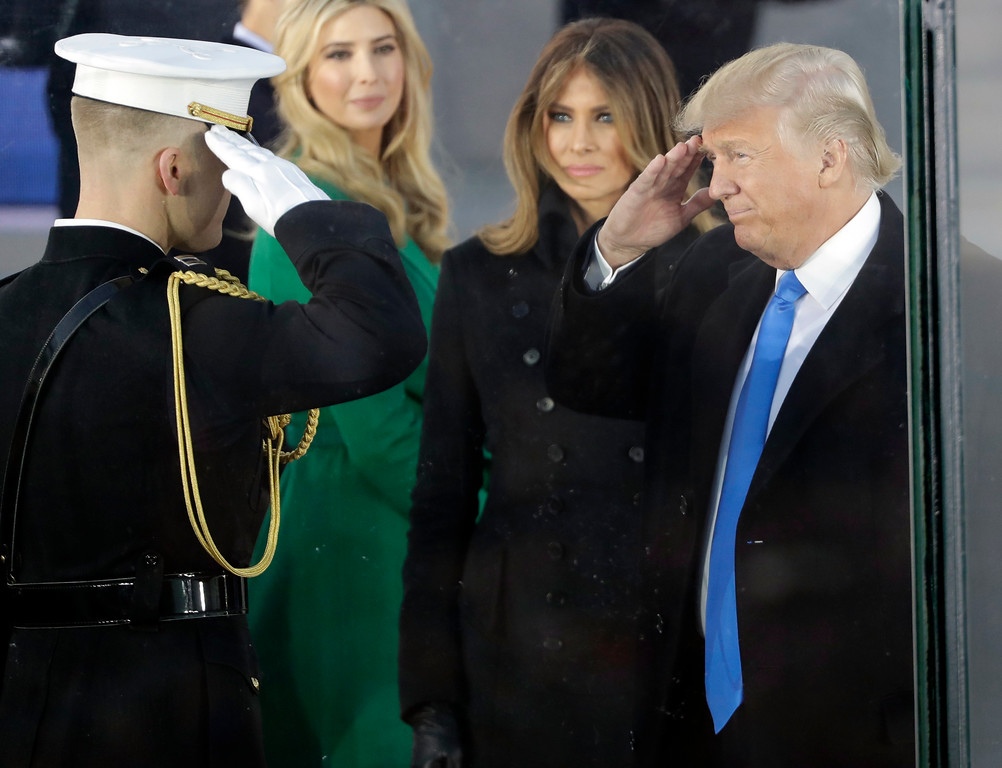 ". President-elect Donald Trump salutes as he arrives with his wife Melania Trump at a pre-Inaugural ""Make America Great Again! Welcome Celebration\"" at the Lincoln Memorial in Washington, Thursday, Jan. 19, 2017. Watching is daughter Ivanka, second from left. (AP Photo/David J. Phillip)"