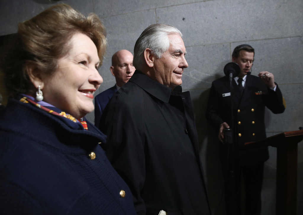 . Secretary of State-designate Rex Tillerson and his wife Renda Tillerson arrive on the West Front of the U.S. Capitol on Friday, Jan. 20, 2017, in Washington, for his inauguration ceremony as the 45th president of the United States. (Win McNamee/Pool Photo via AP)