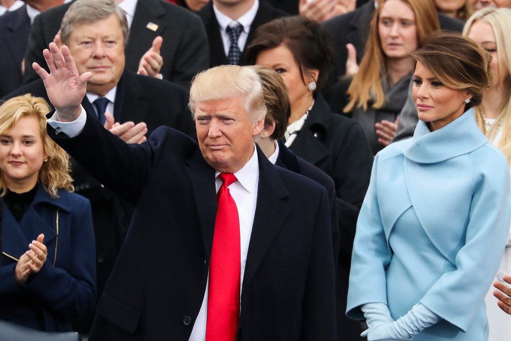 . President-elect Donald Trump waves from the podium as Melania Trump looks on during the 58th Presidential Inauguration at the U.S. Capitol in Washington, Friday, Jan. 20, 2017. (AP Photo/Andrew Harnik)