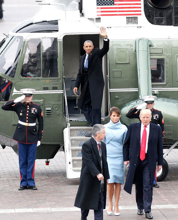 . Former President of the United States Barack Obama waves from a Marine One helicopter as newly elected United States President Donald Trump walks with wife Melania Trump back to the Capitol Building after Trump is sworn in at the 58th Presidential Inauguration on Capitol Hill in Washington, D.C. on January 20, 2017. Photo by John Angelillo/UPI