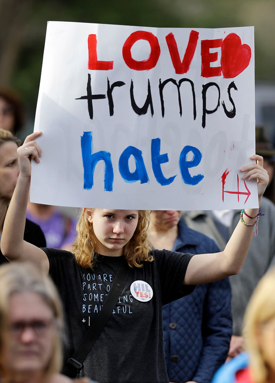 . Lucy Williams takes part in a protest Friday, Jan. 20, 2017, in Nashville, Tenn., organized to combat harsh rhetoric by Donald Trump. The protesters observed 15 minutes of silence during the time Trump took the Presidential oath of office in Washington. (AP Photo/Mark Humphrey)