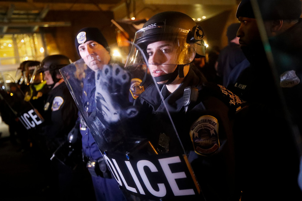 . Riot police form a line against protesters on 14th Street ahead of the presidential inauguration, Thursday, Jan. 19, 2017, in Washington. (AP Photo/John Minchillo)