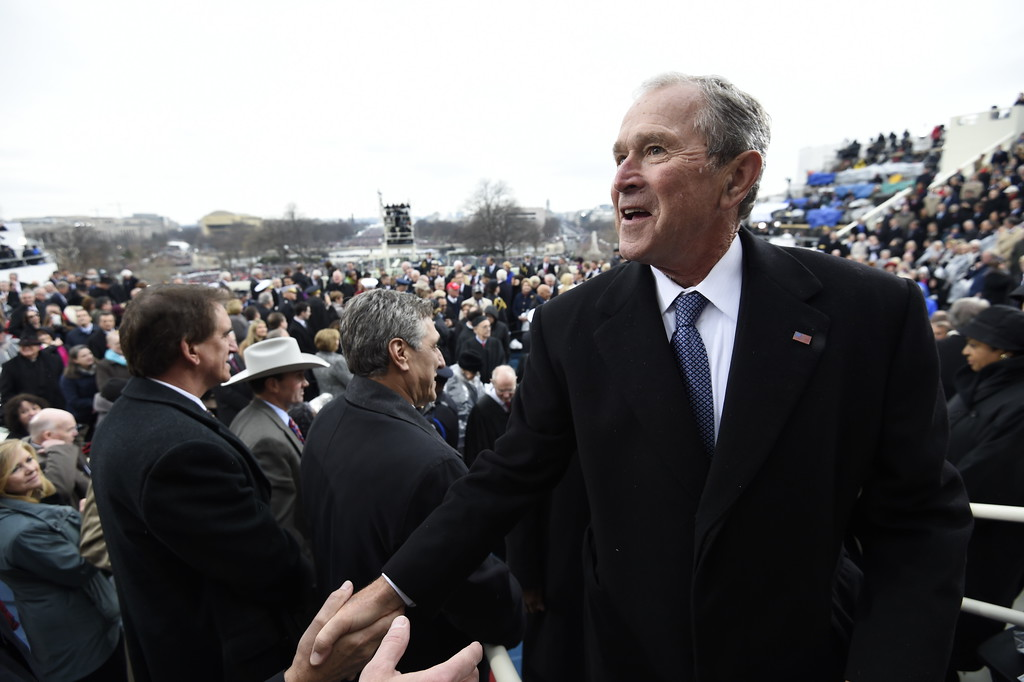 . Former President George W. Bush leaves after the presidential inauguration on Capitol Hill in Washington, Friday, Jan. 20, 2017. (Saul Loeb/Pool Photo via AP)