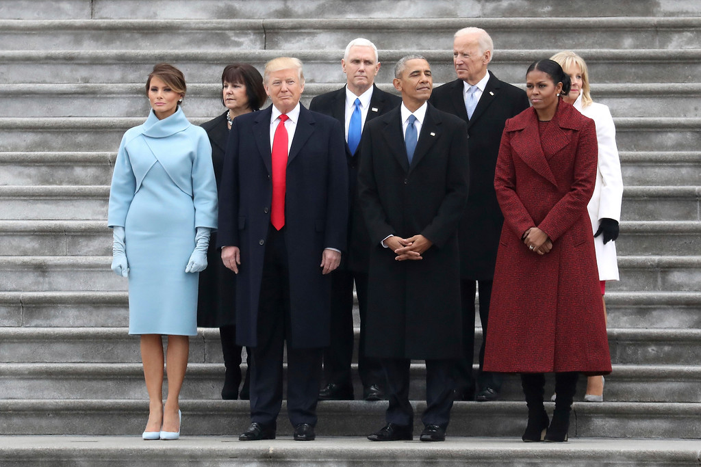 . From left, first lady Melania Trump, Karen Pence, President Donald Trump, Vice President Mike Pence, former president Barack Obama, former vice president Joe Biden, Michelle Obama and Jill Biden stand on the steps of the U.S. Capitol on Friday, Jan. 20, 2017, in Washington, after Trump\'s inauguration ceremony. (Rob Carr/Pool Photo via AP)
