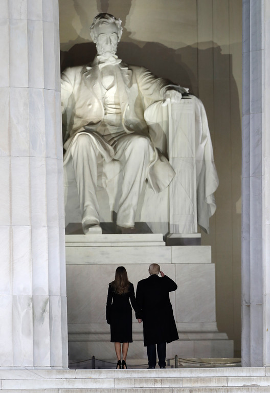 """. President-elect Donald Trump salutes with his wife Melania Trump as they arrive at a pre-Inaugural \""""Make America Great Again! Welcome Celebration\"""" at the Lincoln Memorial in Washington, Thursday, Jan. 19, 2017. (AP Photo/David J. Phillip)"""