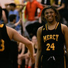 (Tuesday March 4th 2014 - Farmington High School - Farmington MI)  Mercy High's #24 Tyler Parker smiles at teammate Sam Bauer a few seconds before Mercy High defeated Grosse Pointe South during the game Tuesday night at Farmington High. Photo by: Brian B. Sevald