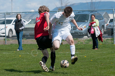 © Paul Conrad/ Pablo Conrad Photography - Mount Baker High School boys take on Meridian during varsity soccer action on Saturday afternoon April 12, 2014, at Meridian High School in Bellingham, Wash. The visiting Mountaineers defeated the Trojans 3-0.