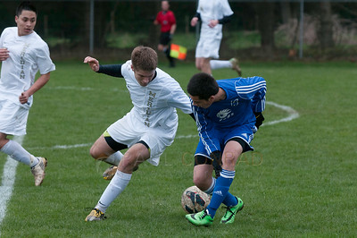 © Paul Conrad/ Pablo Conrad Photography - Sedro-Woolley High School boys take on Meridian on Friday afternoon Mar. 28, 2014. The visiting Cubs defeated the Trojans 2-1.