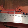 When it is correct the distance from the nut to the bridge will be 330mm with the strings in tune. The bridge should be nearly vertical, leaning very slightly toward the tail. Generally speaking this should be checked every few months with any violin as constant tuning causes the bridge to creep forward. Happy fiddling!