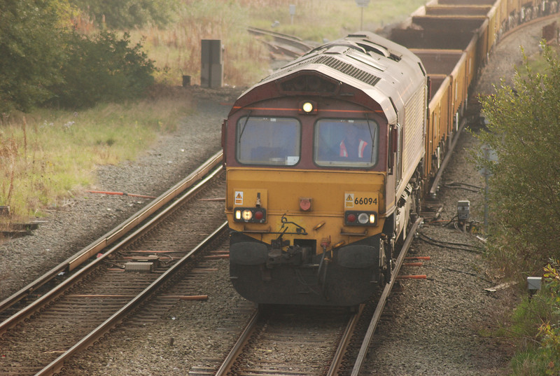 66 094 <br /> <br /> Sits just outside Bidston Station on a spoil train