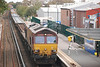 after 66137 was hauled away by 66193 i was able to get a decent shot of 66096 sitting on it's own in the West Kirby bound Platform at Hoylake with the new sleepers and a rake of JNA's on the back with 66046 on another rake of JNA's behind