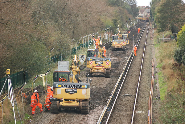 THe diggers wait time for 66602 in the background to ease it's train of JNA's down from Manor Road