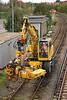 Liebherr Road Railer 940678-4 (Fleet # 6896) <br /> <br /> Prepares to drop a Pandrol Fastclipper by the Crossing hut <br /> <br /> Thanks to the top guys on Yahoo OTP MSG brd for the identification of this bit of kit much appreciated lads ta