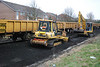 Komatsu Dozer pushes another load towards Komatsu 138 911014-7
