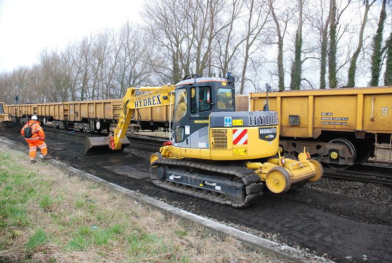 Hydrex Komatsu 138 <br /> <br /> Euro # 911014-7 <br /> <br /> Fleet # 6502 <br /> <br /> waits on the site between Ainsdale and Hillside for the Komatsu D41p Dozer to scoop up another load ready for loading into the wagons