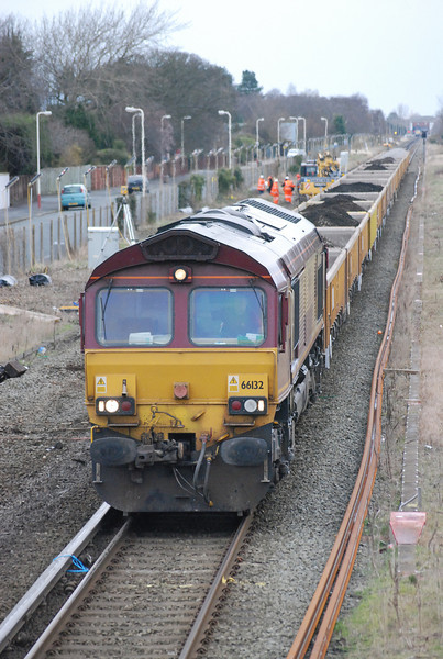 66132 <br /> <br /> on a spoil train near station road crossing Ainsdale