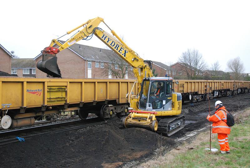Komatsu 138  Euro 911014-7 <br /> <br /> Dumps a load of spoil into a JNA wagon