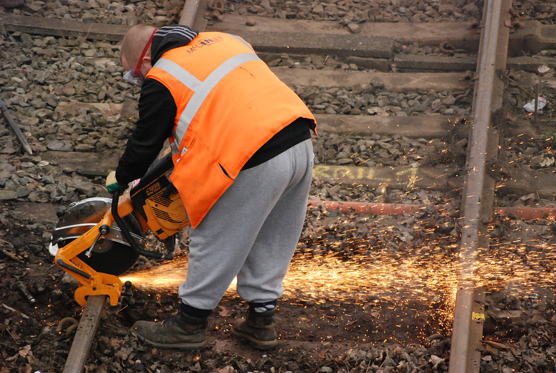 Chummy gets to work with and angle grinder cutting the rail near the edge of the Railway crossing at Ainsdale