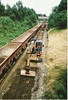Road Railers getting ready to dig the spoil out on the old track bed and load it into 60 099 train