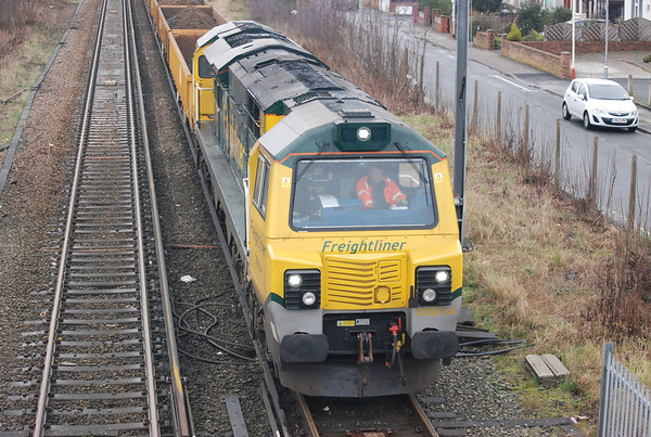 With the Gates down 70 014 starts to haul it's load of JNA's loaded with spoil and also 70 003 train behind as well towards Ainsdale Station
