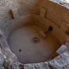 Families lived in architectural units, organized around kivas, circular, subterranean rooms. A kiva typically had a wood-beamed roof held up by six engaged support columns made of masonry above ashelf-like banquette. Other typical features of a kiva included a fire pit or hearth,a ventilation shaft, a deflector (low wall designed to prevent air drawn from the ventilation shaft from reaching the fire directly), and a sipapu ( a small hole in the floor that is ceremonial in purpose).