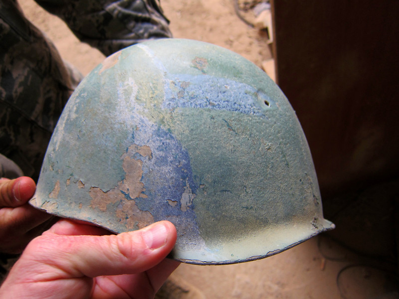 Old Iraqi helmet... former Ba'ath Party headquarters -- © Brandon Lingle