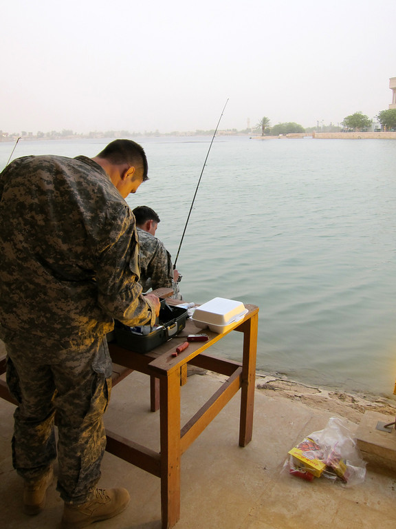 Baghdad fishing, Victory Base Complex -- © Brandon Lingle