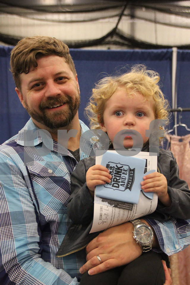 Sunday, October 16, 2016 Iowa Central Community College was the sight of the 2016 Messenger Bridal Show. The event took place in the Career Education Building on their Fort Dodge campus. Shown here (Left to right) is: Jeremy Shulz and his daughter Thea Shulz. Jeremy was a vendor at the event.