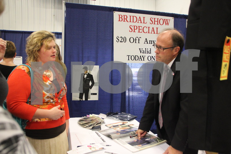 Sunday, October 16, 2016 Iowa Central Community College was the sight of the 2016 Messenger Bridal Show. The event took place in the Career Education Building on their Fort Dodge campus. Seen (in the black suit) is: John Junkman, one of several vendors at the event.