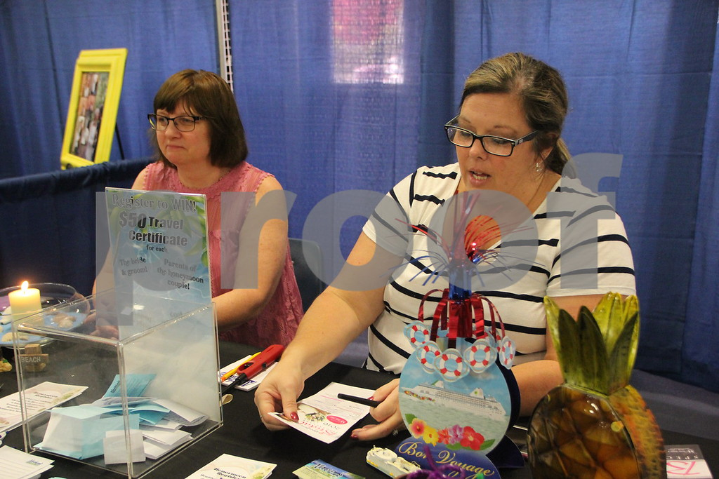 Sunday, October 16, 2016 Iowa Central Community College was the sight of the 2016 Messenger Bridal Show. The event took place in the Career Education Building on their Fort Dodge campus. (Left to right) Kellie Guderian and Michelle Reed, one of the many vendors at the event is pictured here.