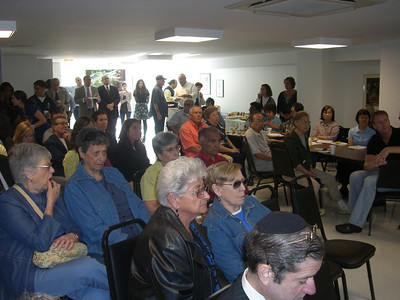 Residents and volunteers listen intently to the welcoming remarks from elected officials and Met Council staff.