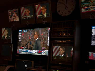 Obama's victory speech on the bank of monitors-of-all-networks.  (Okay, sure, I just watched this on TV like everyone else I know;  but I got to watch it on a LOT of TVs!)  The sharp-eyed will note that the machines in the Graphics department have Seinfeld-themed hostnames.