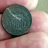 Oldest Coin I have found as of 2017.  It is a US Shield nickel and dated 1869.