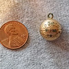 Award charm from 1934 -  penny is only there for scale