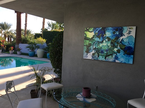 This client designed her patio with this large print in mind to hang near her pool.