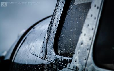 Metal. Rivets. Rain