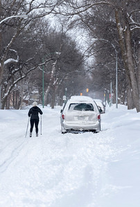 Mel Dupuis skis down a residential street in River Heights in Winnipeg following a Boxing Day winter storm December 26, 2016.