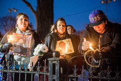 Friends, family, and community came together around John Munroe (in purple ball cap), the son of Marilyn Munroe in front of her home at 298 Pritchard Ave Thursday February 25, 2016 for a Vigil to honour her. Participants lit candles during a ceremony, and walked to the Aboriginal Funeral Chapel afterwards. (David Lipnowski for Metro News)