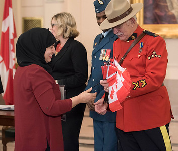 Mina Ahmedzai receives a Canadian flag during a citizenship ceremony as she became a Canadian Citizen at the Manitoba Legislative Building Wednesday February 1, 2017. She is originally from Afghanistan.(David Lipnowski for Metro News)