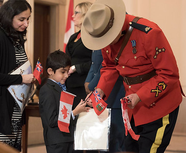 Divya Pahwa and her son Parth receive Canadian flags during a citizenship ceremony after the family became Canadian Citizens at the Manitoba Legislative Building Wednesday February 1, 2017. His family are originally from India. (David Lipnowski for Metro News)