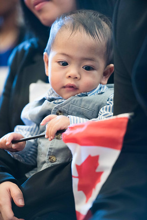 9-month-old Andry Magnayi plays with a Canadian flag during a citizenship ceremony after he and his family became Canadian Citizens at the Manitoba Legislative Building Wednesday February 1, 2017. His family are originally from the Philippines. (David Lipnowski for Metro News)